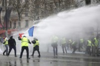Police uses tear gas, water cannon against Paris protesters