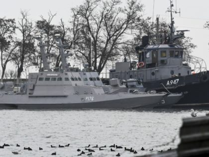 Three Ukrainian ships are seen as they docked after been seized ate Sunday, Nov. 25, 2018, in Kerch, Crimea, Monday, Nov. 26, 2018. The Ukrainian parliament is set to consider a presidential request for the introduction of martial law in Ukraine following an incident in which Russian coast guard ships …