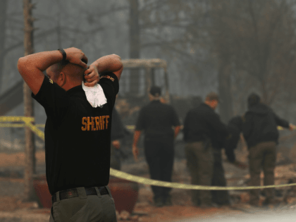 California Fire: Hearses Stand By as Relatives Search for Over 100 Missing Loved Ones