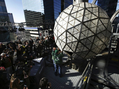 Media watch as workmen demonstrate the replacement of a panel on the New Year's Eve ball on top of a building in Times Square, New York, Thursday, Dec. 27, 2018. Preparations for New Year's Eve in Times Square are taking shape, and some of those shapes are 192 new crystal …