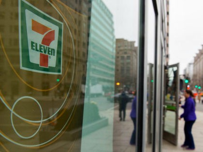 A woman walks into a 7-Eleven store in Washington, DC on January 10, 2018. US immigration agents raided nearly 100 7-Eleven convenience stores around the country, sending a warning to businesses not to hire illegal immigrants, officials said. / AFP PHOTO / Andrew CABALLERO-REYNOLDS (Photo credit should read ANDREW CABALLERO-REYNOLDS/AFP/Getty …