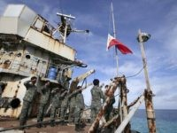 "FILE - In this March 29, 2014, file photo, Philippine Marines deployed on the Philippine Navy ship LT 57 Sierra Madre practice the ""relieving the watch"" ceremony near Second Thomas Shoal in the South China Sea. In one of the world's most disputed waters, the puny Philippine navy doesn't stand …"