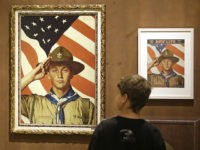 FILE - In this July 22, 2013, file photo, Andrew Garrison, 11, of Salt Lake City, looks over the Rockwell exhibition at the Mormon Church History Museum in Salt Lake City, Utah. The Mormon church's new youth program it will roll out in 2020 when it cuts all ties with …