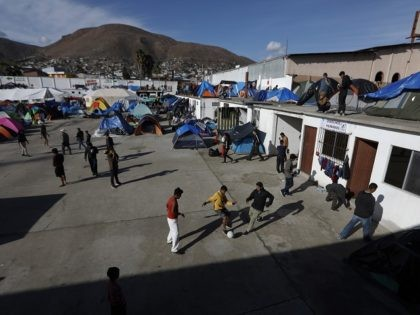Migrants play soccer at a former concert venue serving as a shelter for migrants in Tijuana, Mexico, Sunday, Dec. 2, 2018. The city government closed down on Saturday a migrant shelter at a sports complex close to the U.S. border, moving thousands of the more than 6,000 Central Americans who …