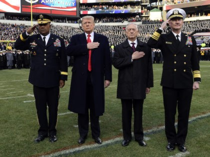 President Donald Trump, second from left, is joined by, from left, West Point Superintendent Lt. Gen. Darryl A. Williams, Defense Secretary Jim Mattis and Naval Academy Superintendent Vice Adm. Ted Carter, during the playing of the national anthem before the start of the Army-Navy NCAA college football game in Philadelphia, …