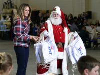 First lady Melania Trump speaks as she stands next to Santa during a Toys for Tots event at Joint Base Anacostia-Bolling in Washington, Tuesday, Dec. 11, 2018. (AP Photo/Susan Walsh)