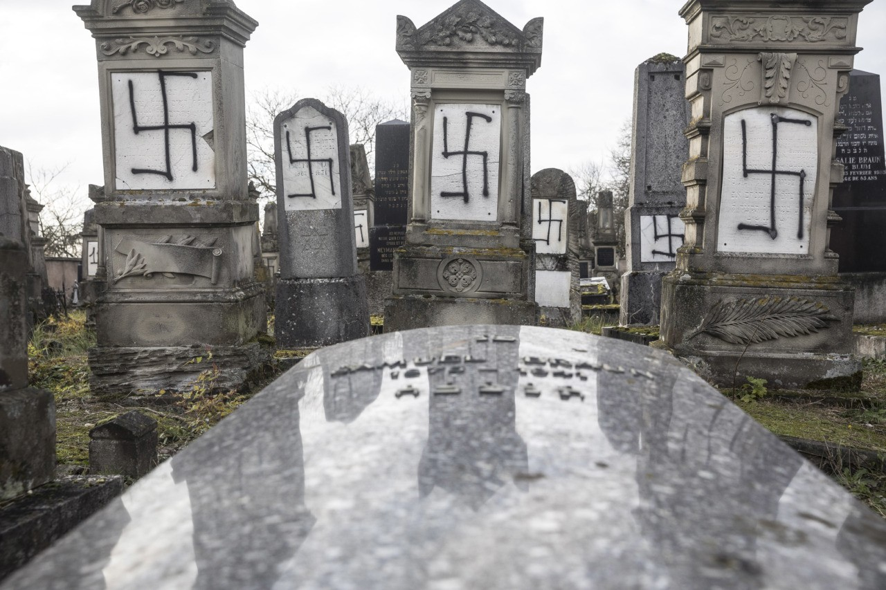 Jewish tombstones are desecrated with swastikas in the Herrlisheim Jewish cemetery, north of Strasbourg, eastern France, Thursday, Dec. 13, 2018. Dozens of tombs were defaced were discovered Tuesday. (AP Photo/Jean-Francois Badias)