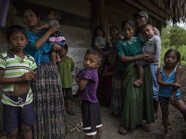 Members of the Caal Maquin family and neighbors stand in front of Claudia Maquin's house in Raxruha, Guatemala, on Saturday, Dec. 15, 2018. Claudia Maquin's daughter, 7-year-old Jakelin Amei Rosmery Caal, died in a Texas hospital, two days after being taken into custody by border patrol agents in a remote …
