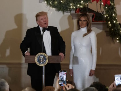 President Donald Trump, joined by first lady Melania Trump, speaks during the Congressional Ball in the Grand Foyer of the White House in Washington, Saturday, Dec. 15, 2018. (AP Photo/Carolyn Kaster)