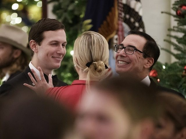 From left, White House senior adviser Jared Kushner, Ivanka Trump, the daughter of President Donald Trump, and Treasury Secretary Steve Mnuchin, talk during the Congressional Ball in the Grand Foyer of the White House in Washington, Saturday, Dec. 15, 2018. (AP Photo/Carolyn Kaster)