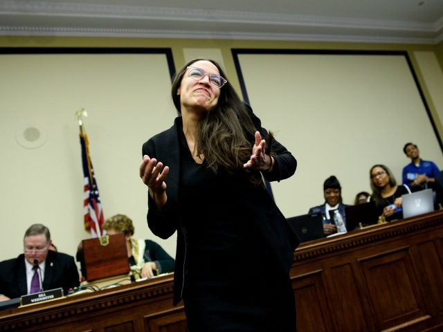US Representative-elect Alexandria Ocasio-Cortez (D-NY) reacts after drawing a lottery number for her new office on Capitol Hill November 30, 2018 in Washington, DC. (Photo by Brendan Smialowski / AFP) (Photo credit should read BRENDAN SMIALOWSKI/AFP/Getty Images)