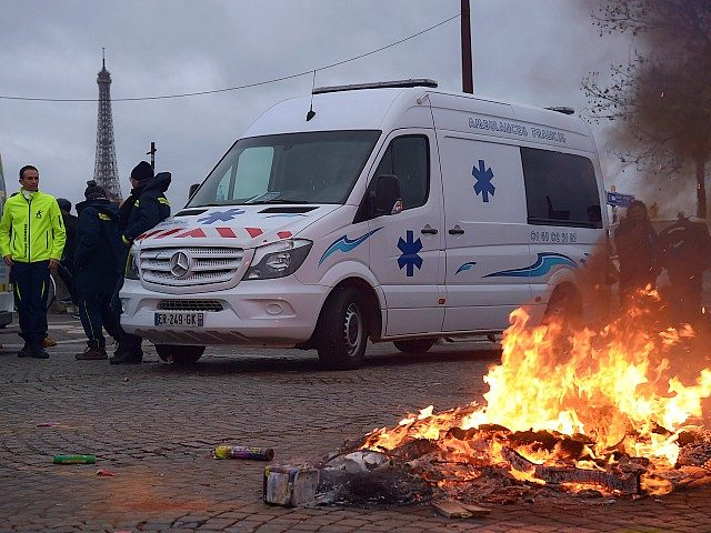 Ambulance drivers demonstrate near the French National Assembly in Paris, on December 3, 2018, to protest against their working conditions and call for a withdrawal of the article 80 of the finance act on social security. (Photo by Lucas BARIOULET / AFP) (Photo credit should read LUCAS BARIOULET/AFP/Getty Images)