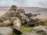 OKEHAMPTON, ENGLAND - SEPTEMBER 26: Soldiers from 6 RIFLES fire live ammunition from a General Purpose Machine Gun (GPMG) on the range at Okehampton Camp, Dartmoor, during the 6th Battalion, The Rifles' Annual Deployment Exercise near Okehampton on September 26, 2017 in Devon, England. The Reservists soldiers were joined by …