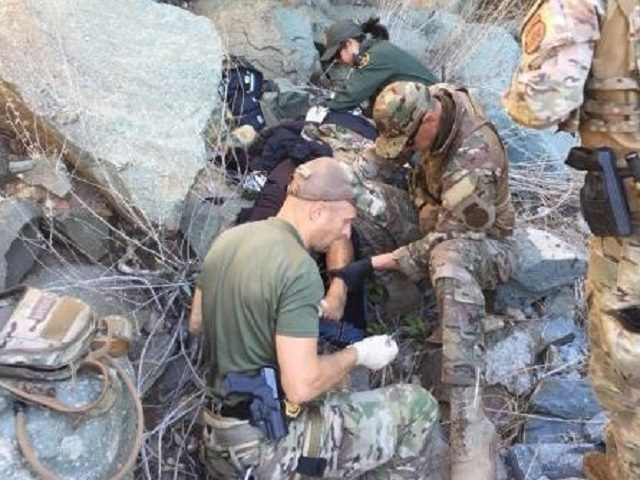 Border Patrol BORSTAR agents rescue a migrant woman who fell into a steep canyon while illegally entering the U.S. (Photo: U.S. Border Patrol/San Diego Sector)