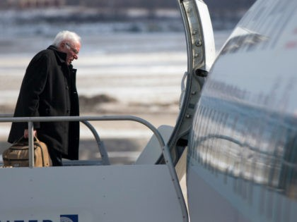 Democratic presidential candidate, Sen. Bernie Sanders, I-Vt. boards his campaign plane in Milwaukee, Friday, Feb. 12, 2016, en route to Minneapolis. (AP Photo/Evan Vucci)