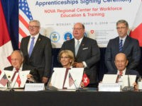 Secretary DeVos, Ivanka Trump, Secretary Acosta, Secretary Ross, and Swiss Economics Minister Johann N. Schneider-Ammann joined together to sign an MOU encouraging cooperation between the Switzerland and the U.S. in the field of apprenticeships.