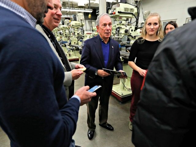 Former New York City Mayor Michael Bloomberg, center, talks with students in the Wind Technology program at Des Moines Area Community College, Tuesday, Dec. 4, 2018, in Ankeny, Iowa.