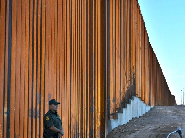 Border Patrol officers keep watch before US Department of Homeland Security Secretary Kirstjen M. Nielsen inaugurates the first completed section of President Trumps 30-foot border wall in the El Centro Sector, at the US Mexico border in Calexico, California on October 26, 2018. (Border Patrol officers keep watch before US …