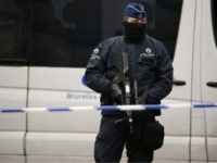 An armed Belgian police officer stands guard near Maelbeek - Maalbeek subway station in Brussels on March 23, 2016, a day after triple bomb attacks in the Belgian capital killed about 35 people and left more than 200 people wounded. A series of explosions claimed by the Islamic State group …