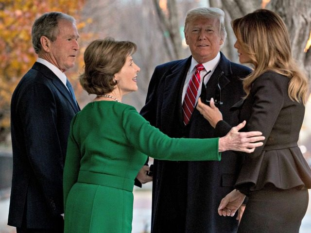 President Donald Trump, second from right, and first lady Melania Trump, right, are greeted by former President George Bush and former first lady Laura Bush outside the Blair House across the street from the White House in Washington, Tuesday, Dec. 4, 2018.