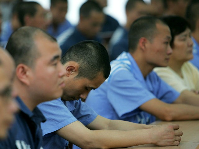 Inmates attend a ceremony to mark Mother's Day with some of their mothers at Chongqing Prison May 8, 2005 in Chongqing Municipality, China. The prison has invited mothers of inmates to celebrate Mother's Day during an event at the facility. China has carried out prison reform in big cities like …