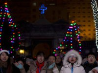 Chinese catholics attend a Christmas Eve Mass service at the official Catholic church South Cathedral in Beijing, China, Tuesday, Dec. 24, 2013. China and the Vatican have no diplomatic ties and the ruling Communist Party forced Chinese Catholics to sever their ties in the 1950s. China officially records about 6 …
