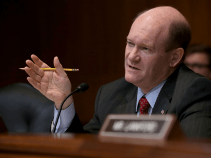 Senate Appropriations Committee's Financial Services and General Government Subcommittee ranking member Sen. Chris Coons (D-DE) questions U.S. Treasury Secretary Steven Mnuchin during a hearing in the Dirksen Senate Office Building on Capitol Hill May 22, 2018 in Washington, DC. Mnuchin testified that the U.S. didn't mean to 'put ZTE out …