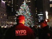 Counterterrorism police stand guard near the Christmas tree at Rockefeller Center in New York City in 2017 (GETTY IMAGES NORTH AMERICA/AFP/File JOHN MOORE)