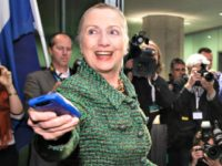 Clinton Hands over Phone