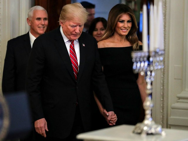 WASHINGTON, DC - DECEMBER 6: (AFP-OUT) President Donald Trump and first lady Melania Trump attend a Hanukkah reception in the East Room of the White House on December 6, 2018 in Washington, DC. (Photo by Oliver Contreras-Pool/Getty Images)