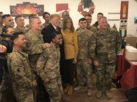 President Donald Trump and Melania Trump visit U.S. troops at Andrews Air Force Base on December 25, 2018.