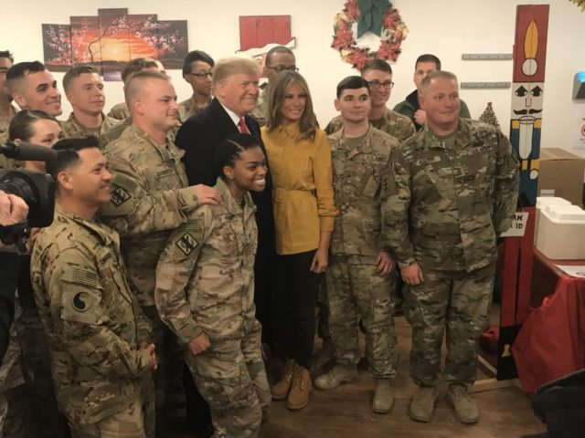 President Donald Trump and Melania Trump visit U.S. troops at Andrews Air Force Base on December 25, 2018.