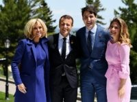 QUEBEC CITY, QC - JUNE 08: French President Emmanuel Macron (C-L) and wife Brigitte Macron (L) pose with Prime Minister of Canada Justin Trudeau and wife Sophie Gregoire during the G7 official welcome at Le Manoir Richelieu on day one of the G7 meeting on June 8, 2018 in Quebec …