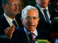 Former Colombian president (2002-2010) and senator Alvaro Uribe Velez (C) answers questions during a press conference at his residence in Rionegro, Antioquia department, Colombia on July 30, 2018. - Uribe has resigned from the senate on July 24, 2018 after he was formally placed under investigation by the Colombian Supreme …