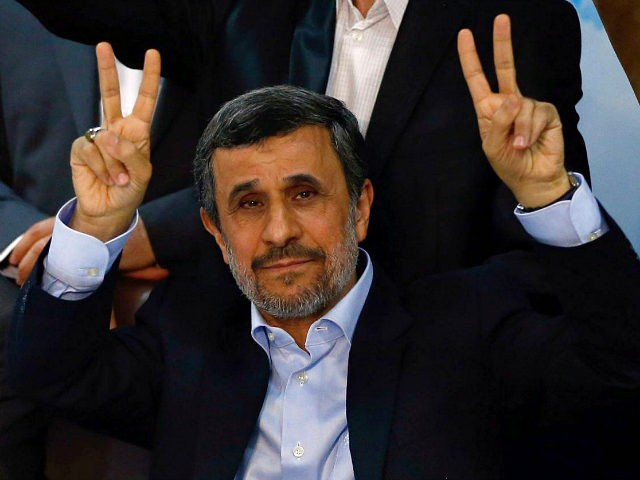 Former Iranian president Mahmoud Ahmadinejad (C) flashes the sign for victory at the Interior Ministry's election headquarters as candidates begin to sign up for the upcoming presidential elections in Tehran on April 12, 2017. Ahmadinejad had previously said he would not stand after being advised not to by supreme leader …