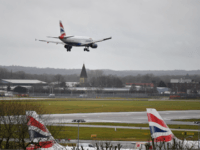 A British Airways Airbus 320-232 aircraft prepares to land at London Gatwick Airport, south of London, on December 21, 2018, as flights resumed following the closing of the airfield due to a drones flying. - British police were Friday considering shooting down the drone that has grounded flights and caused …