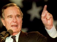 Former President George H.W. Bush pointing up