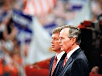 In this Aug. 18, 1988 file photo, Republican presidential candidate George H.W. Bush and his running mate Sen. Dan Quayle, R-Ind., stand together during the final night of the Republican National Convention in New Orleans. Mitt Romney did not mention the war in Afghanistan, where 79,000 US troops are fighting, …