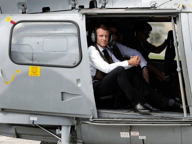 French President Emmanuel Macron looks out from a helicopter after landing on September 30, 2018 on the French Caribbean island of Saint Barthelemy (St. Barts), during his trip to the French West Indies. (Photo by Thomas SAMSON / POOL / AFP) (Photo credit should read THOMAS SAMSON/AFP/Getty Images)