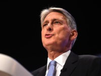 BIRMINGHAM, ENGLAND - OCTOBER 01: Chancellor Of The Exchequer Philip Hammond speaks during day two of the annual Conservative Party Conference on October 1, 2018 in Birmingham, England. (Photo by Jeff J Mitchell/Getty Images)