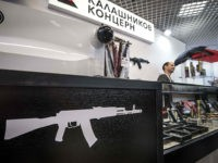 Merchandise is seen at the Kalashnikov Group store on Arbat street in Moscow on October 14, 2018. - The Kalashnikov Group, known for its famousAK-47 machine gun, recently opened a shop in central Moscow. The shop sells clothes, accessories, souvenirs with the company's brand as well pnematic arms and almost …