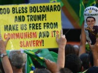 Supporters of Brazilian right-wing presidential candidate Jair Bolsonaro take part in a rally along Paulista Avenue in Sao Paulo Brazil on October 21 2018. - Barring any last-minute upset, Brazil appears poised to elect Jair Bolsonaro, a populist far-right veteran politician, as its next president in a week's time. (Photo …