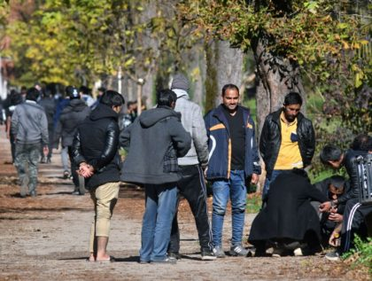 Groups of African and Asian migrants are seen gathering, in a park, near migrants centers in Northern-Bosnian town of Bihac, on October 25, 2018. - In their struggle with large number of in coming migrants, Bosnian authorities have provided two additional capacities, in abandoned army barracks in Hadzici and a …