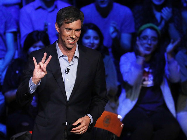HOUSTON, TEXAS - OCTOBER 30: U.S. Senate candidate Rep. Beto O'Rourke (D-TX) flashes the University of Houston hand sign during a town hall meeting hosted by MSNBC at the Cullen Performance Center at the university October 30, 2018 in Houston, Texas. With one week until Election Day, O'Rourke is running …