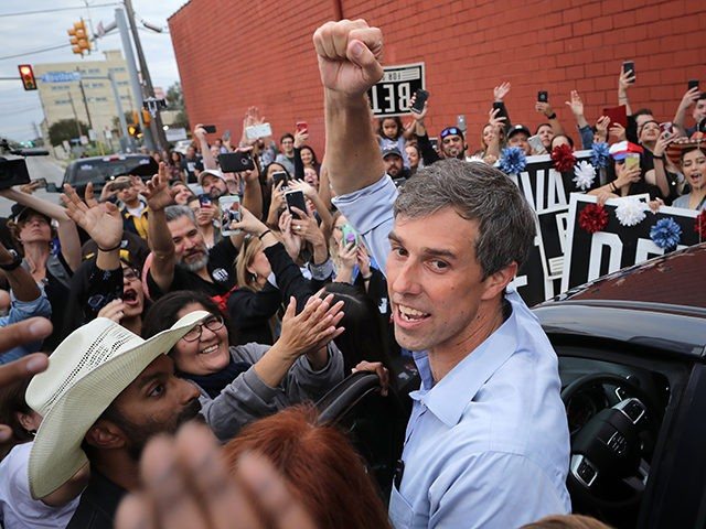 SAN ANTONIO, TEXAS - NOVEMBER 04: U.S. Senate candidate Rep. Beto O'Rourke (D-TX) pumps his fist for a cheering crowd before departing a campaign rally at the Alamo City Music Hall November 04, 2018 in San Antonio, Texas. As Election Day approaches polls have shown the gap narrow between O'Rourke …