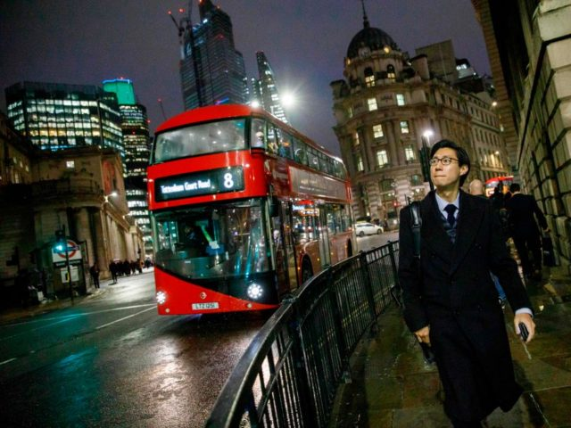 A red London bus makes it's way through the City of London on November 28, 2018 (Photo by Tolga AKMEN / AFP) (Photo credit should read TOLGA AKMEN/AFP/Getty Images)
