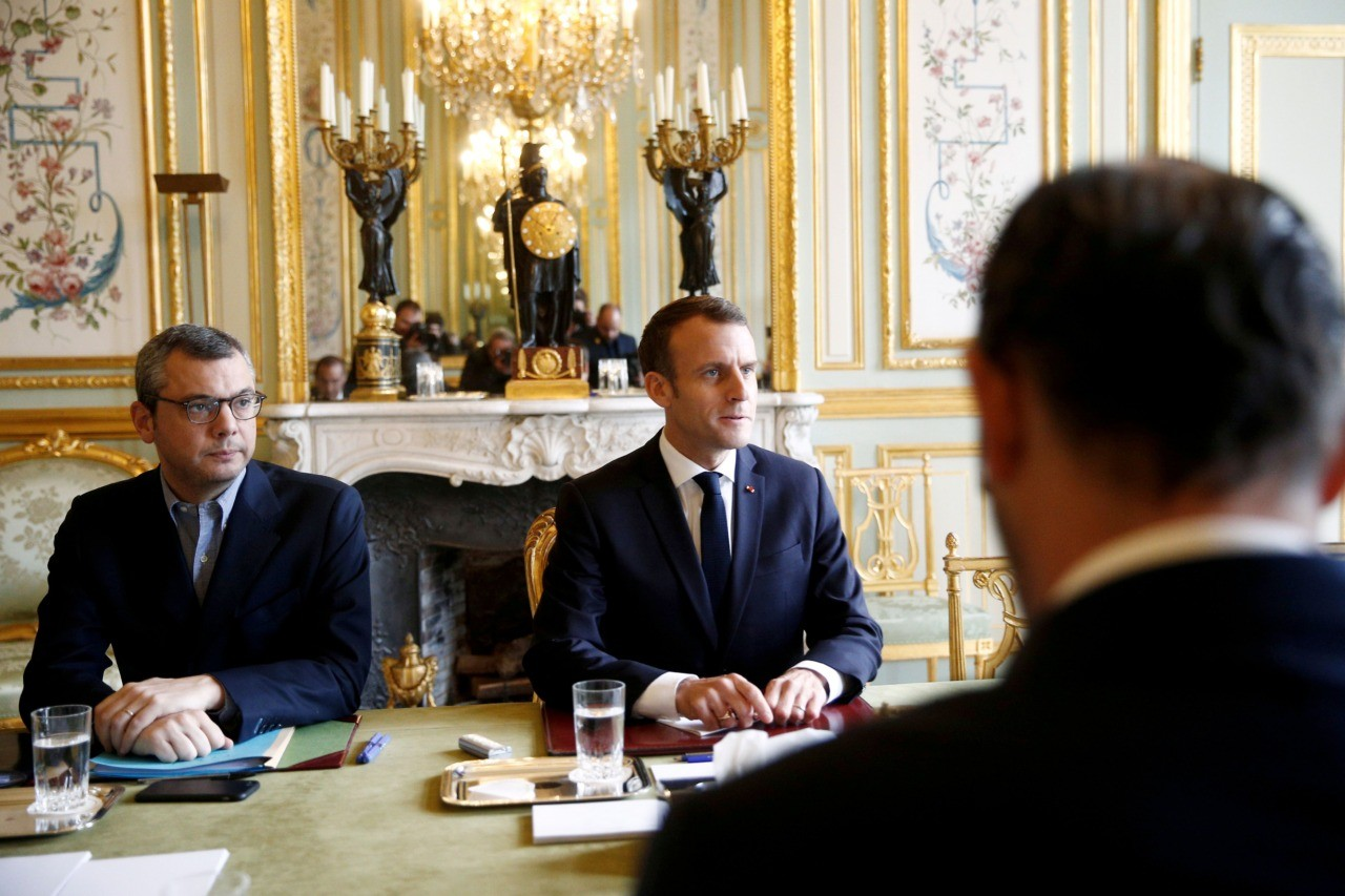 "French President Emmanuel Macron (C) sits in front of French Prime Minister Edouard Philippe (back) during a meeting at the Elysee Palace in Paris on December 2, 2018, a day after clashes between police and yellow vest protesters. - Anti-government protesters torched dozens of cars and set fire to storefronts during daylong clashes with riot police across central Paris on December 1, as thousands took part in fresh ""yellow vest"" protests against high fuel taxes. (Photo by STEPHANE MAHE / POOL / AFP) (Photo credit should read STEPHANE MAHE/AFP/Getty Images)"