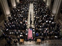 WASHINGTON, DC - DECEMBER 05: (AFP OUT) The Honor Guard carries the casket of former U.S. President George H. W. Bush down the center isle following the state funeral at the Washington National Cathedral on December 5, 2018 in Washington, DC. President Bush will be buried at his final resting …