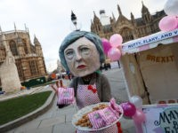 LONDON, ENGLAND - DECEMBER 10: A person dressed as a caricature of Prime Minister Theresa May hands out 'May's Brexit Fudge' in Parliament Square on December 10, 2018 in London, England. The Prime Minister held meetings with her backbench MPs today in the hope of reassuring them about her EU …