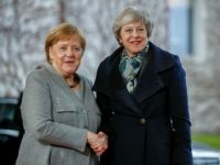 German Chancellor Angela Merkel (R) greets British Prime Minister Theresa May at the Chancellery in Berlin, on December 11, 2018, prior bilateral talks. - Embattled British Prime Minister Theresa May launched a tour of European capitals on December 11, 2018 in a desperate bid to salvage her Brexit deal, a …